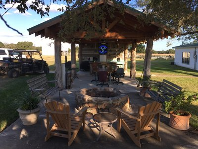 pavilion and garden courtyard for relaxing between hunts at oak creek ranch in columbus, tx